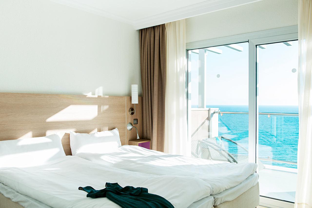 Merinäköalallisen kolmion makuuhuone